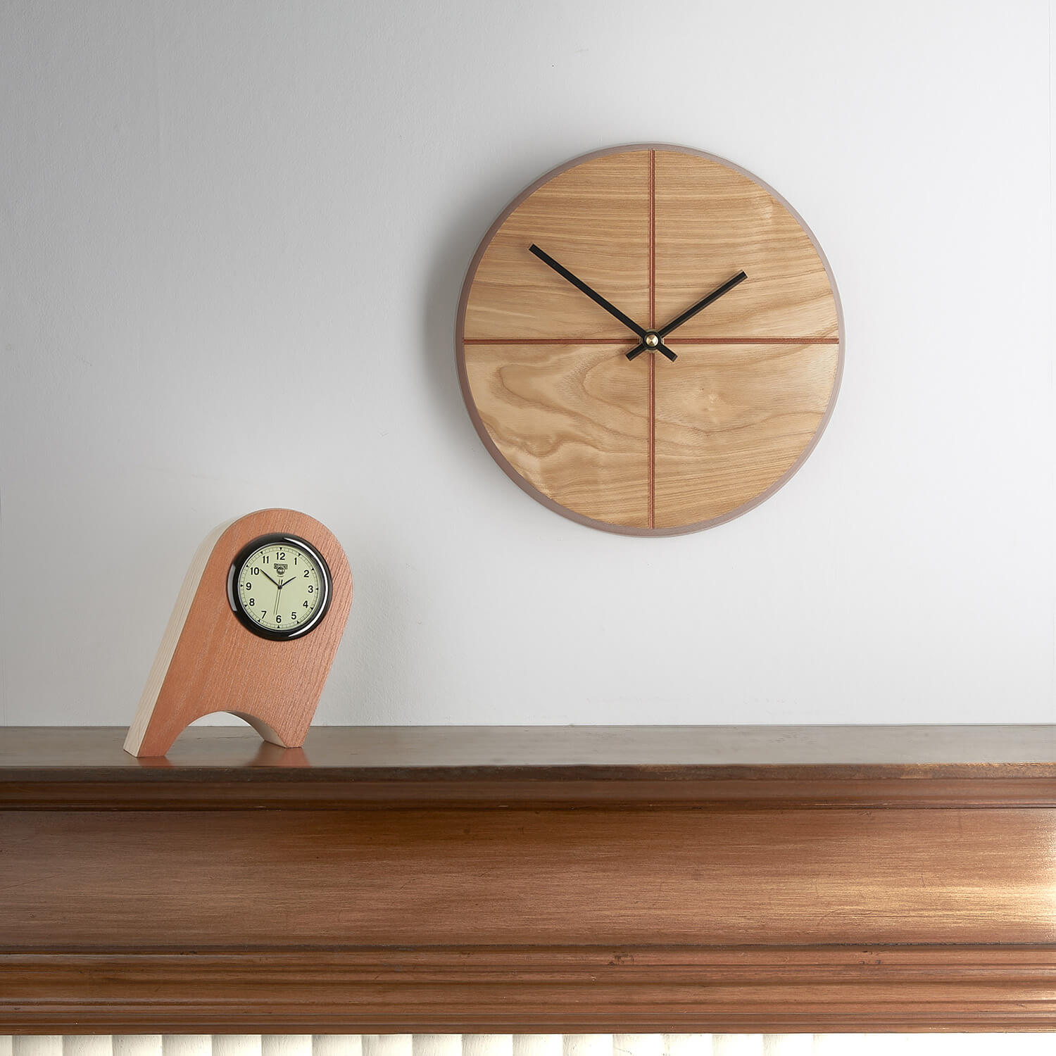 Simple contemporary photograph of clocks handmade by designer maker Humblewood