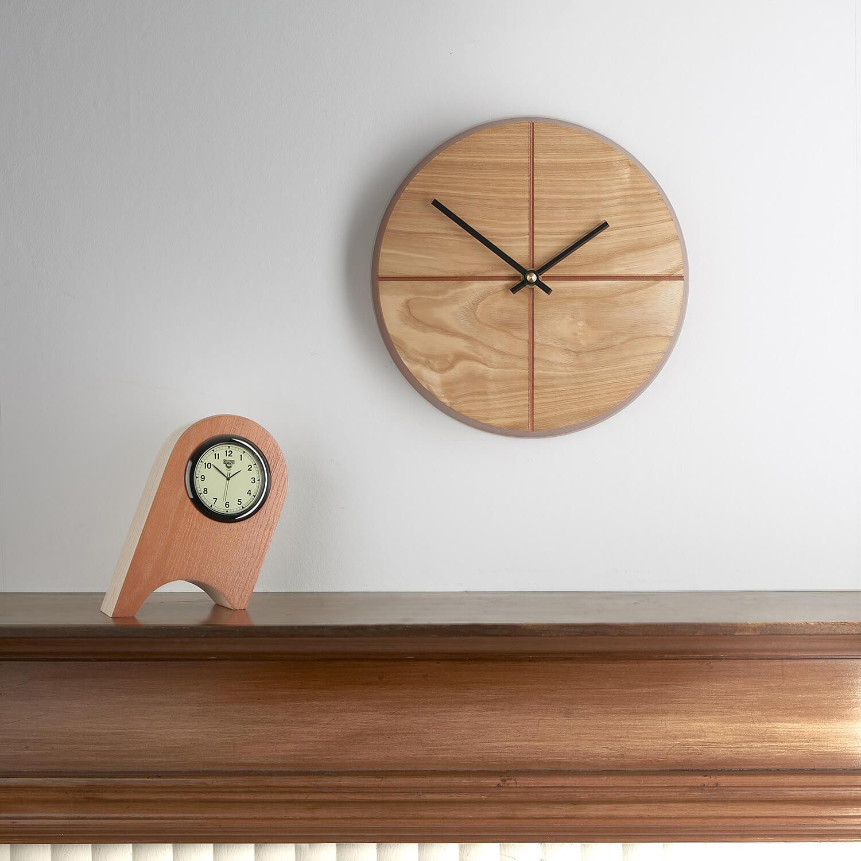 Simple contemporary photograph of clocks handmade by designer maker Humblewood