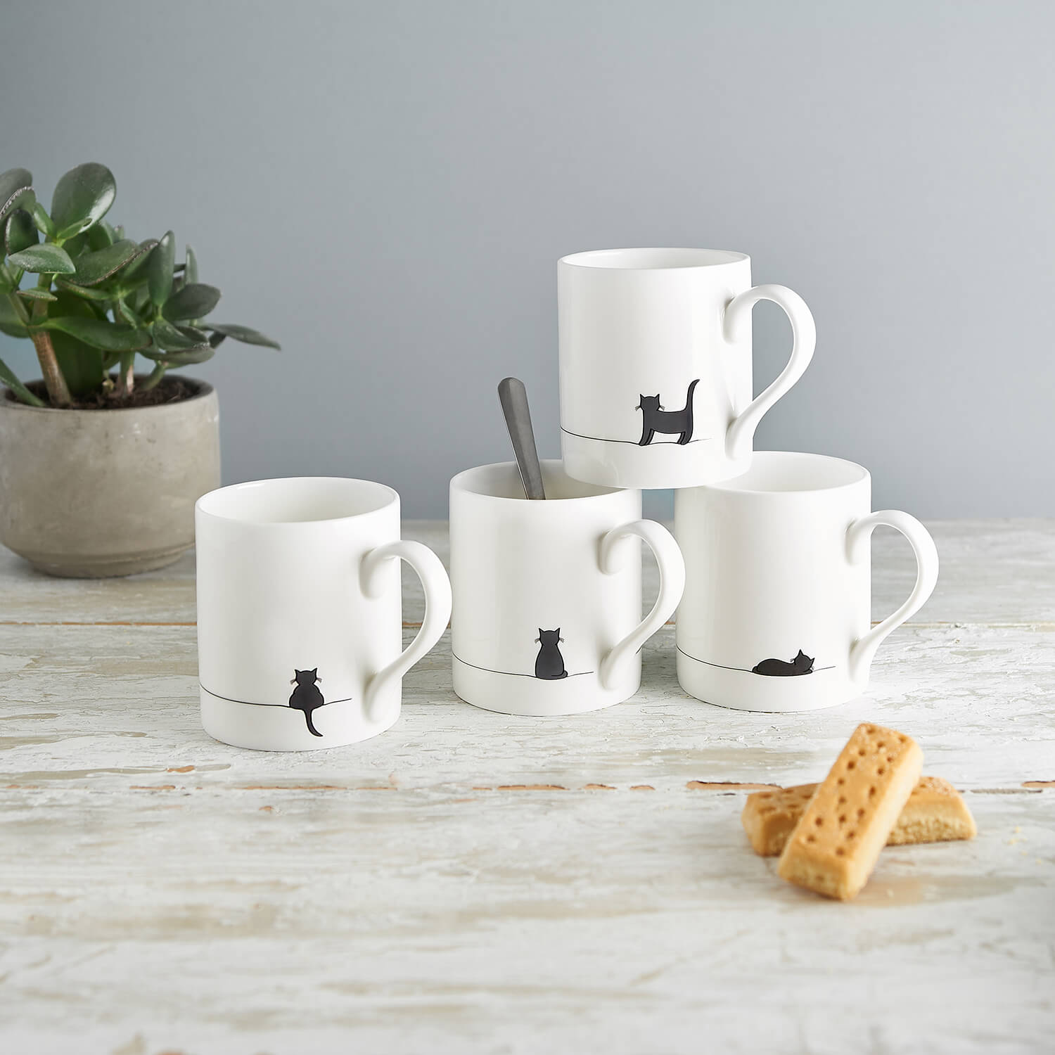 Simple product photograph of four ceramics mugs by Jin Designs
