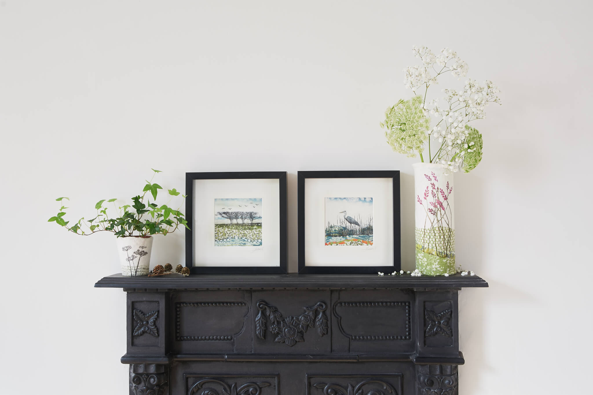 The studio fireplace with Lindsey Tyson's work on the mantlepiece