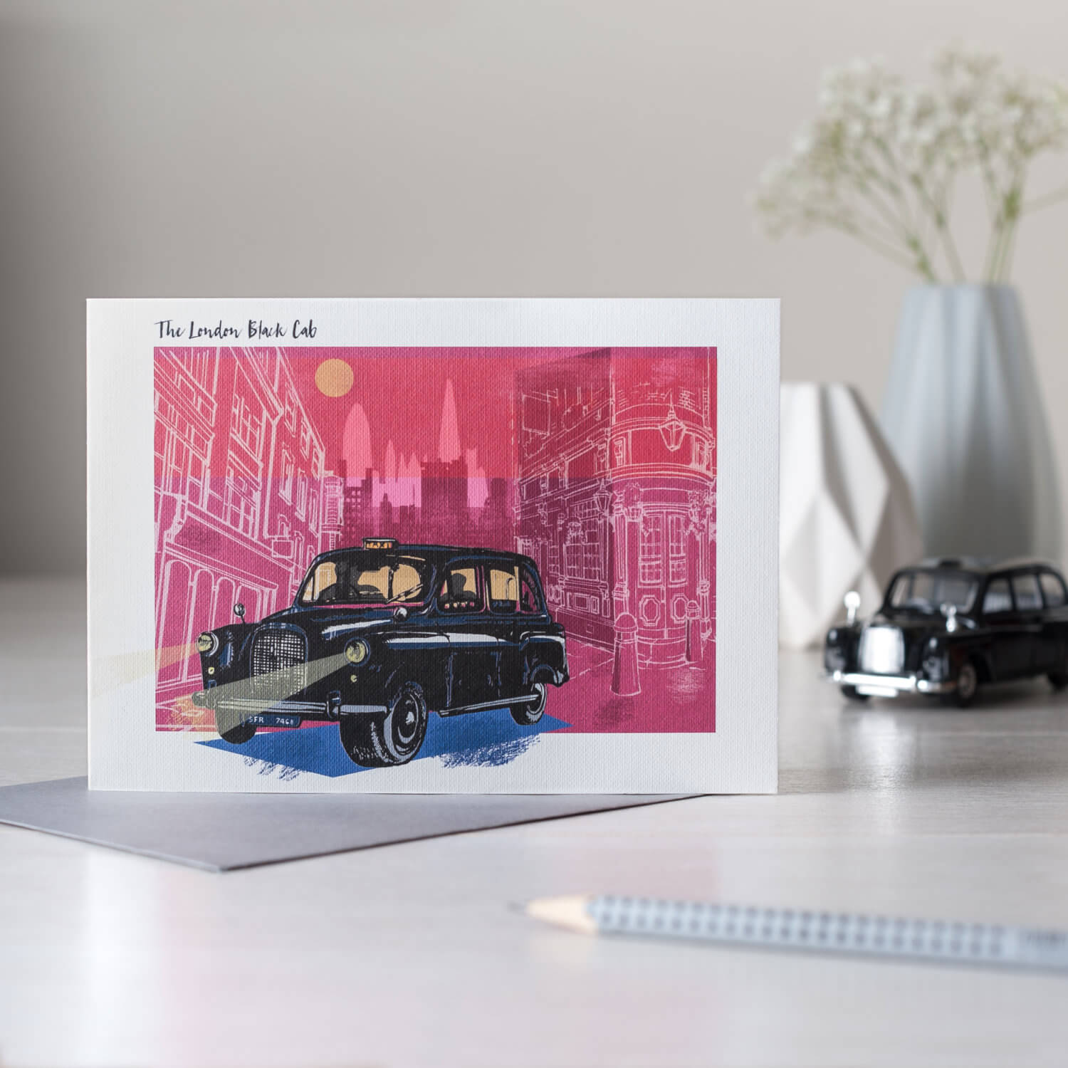 Black London taxi cab greetings card and accompanying props