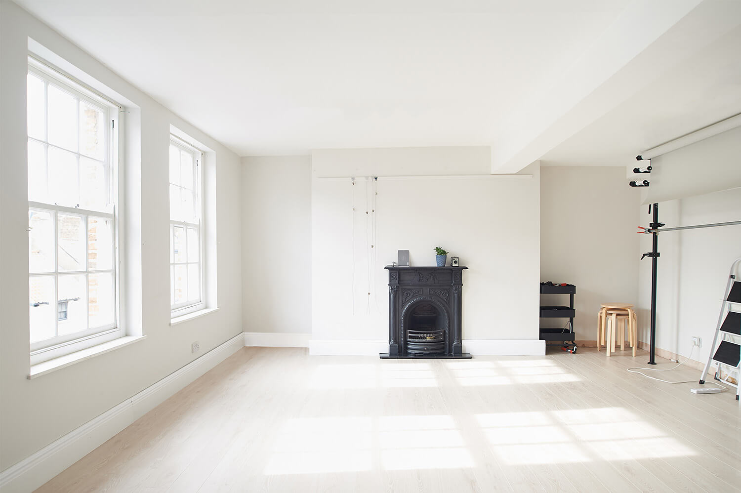 Product photography studio showing the fireplace, sash windows, background system