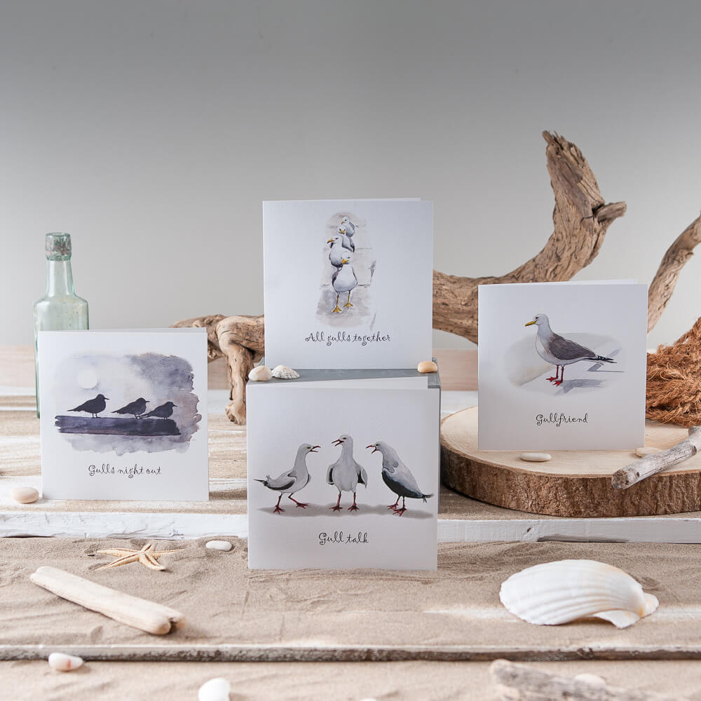 Coastal product photography with associated props including driftwood and seashells