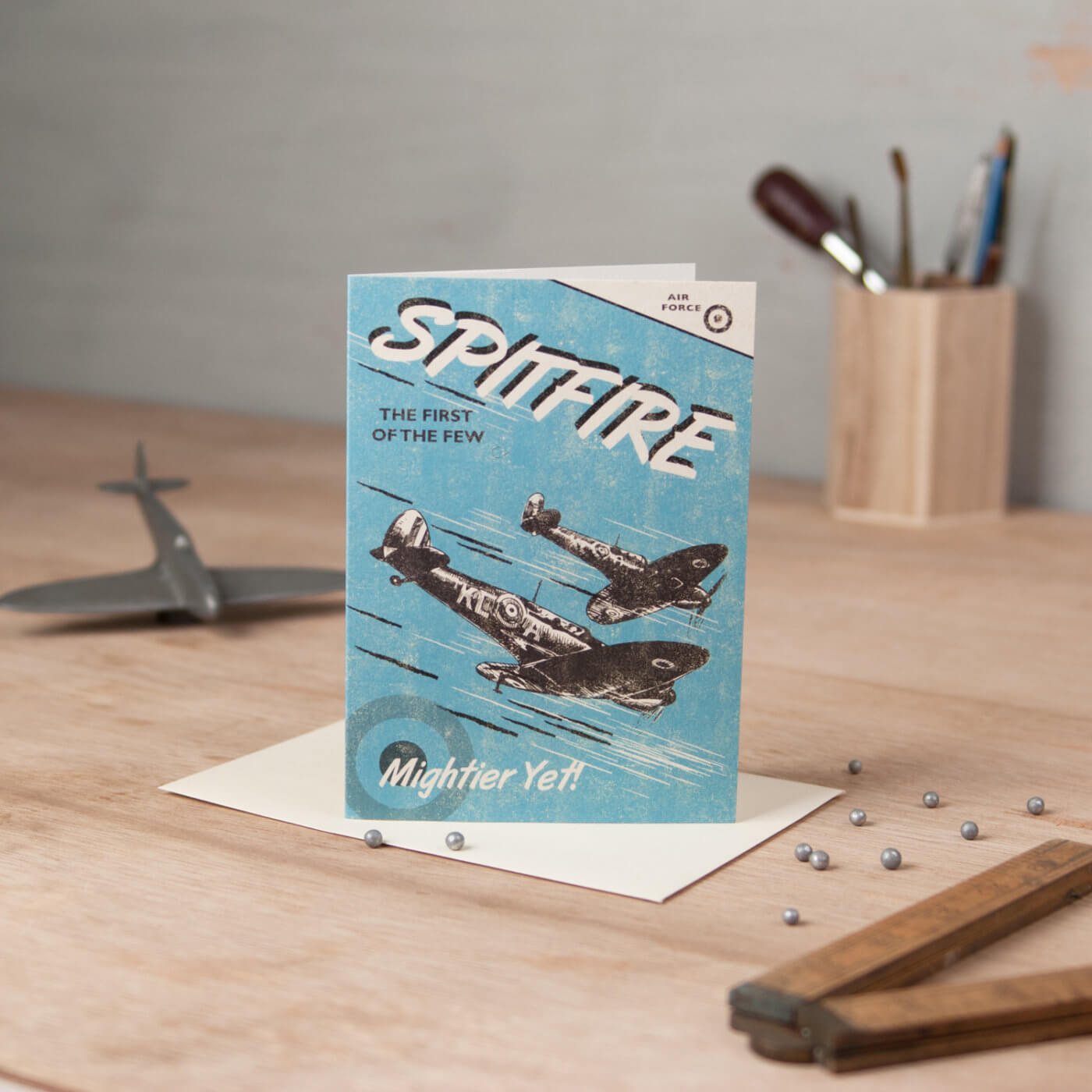 Spitfire mens range greetings card with silver bullets and industrial props