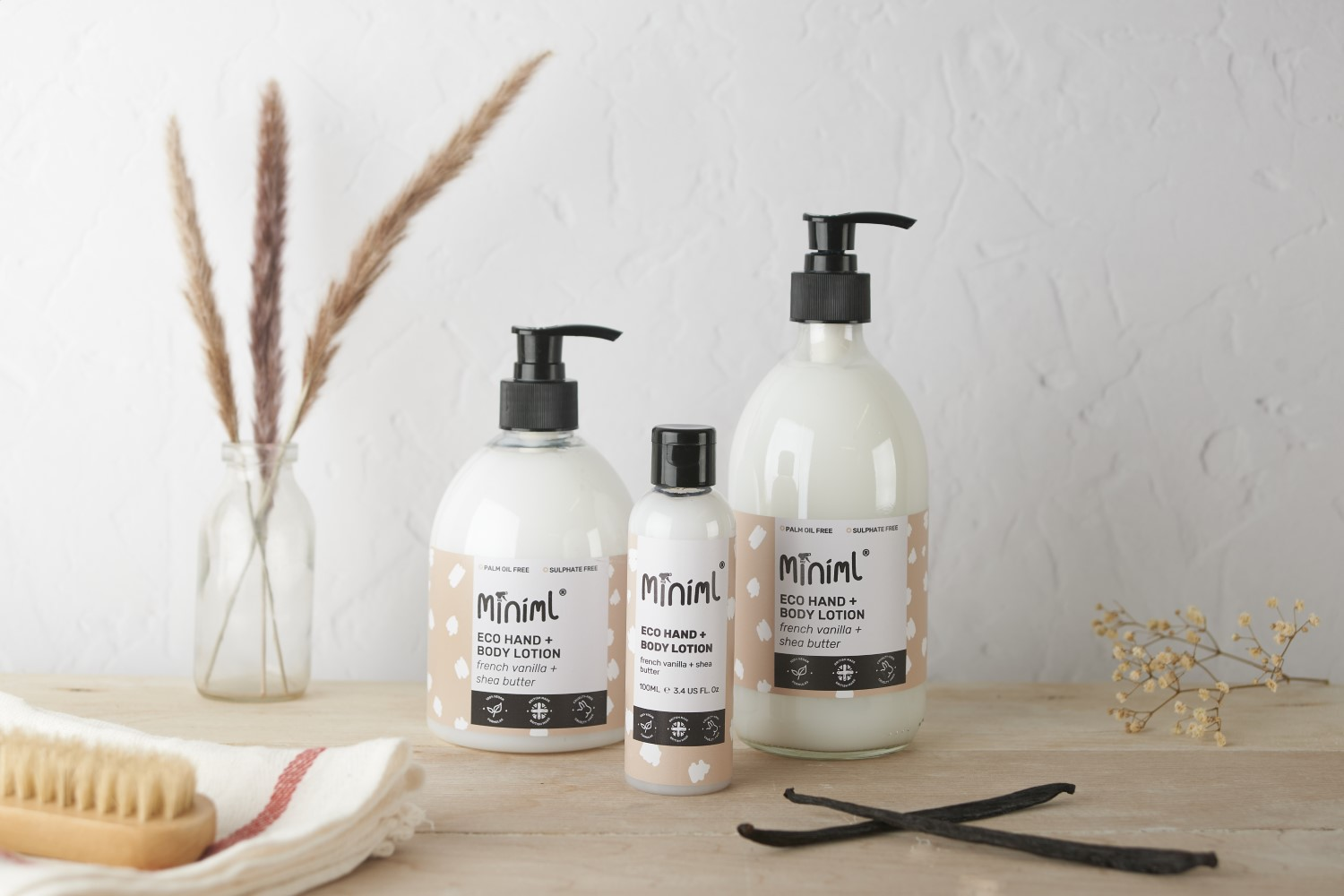 A styled product photograph of apothecary product bottles with an old plaster effect backdrop