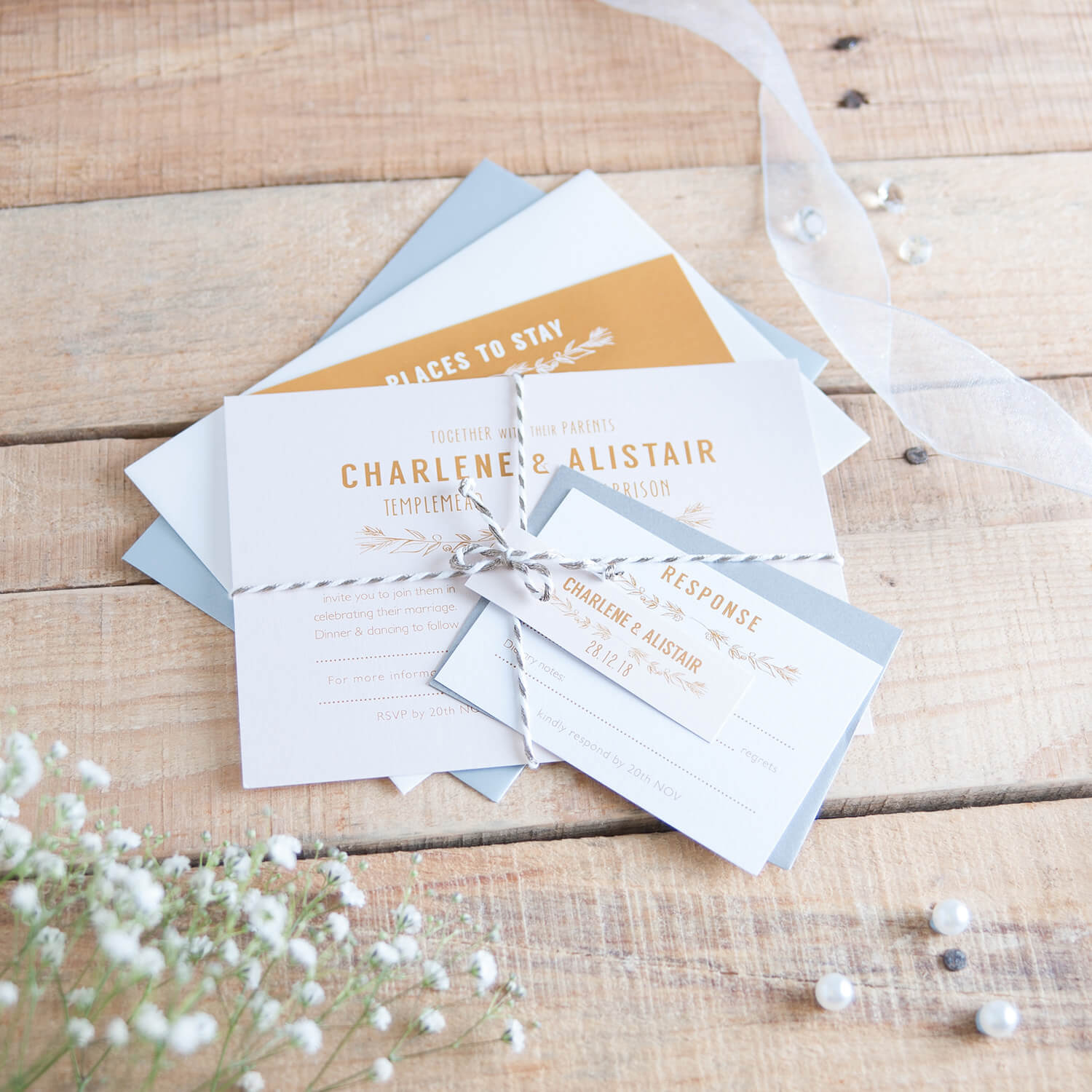 Wedding stationery invitations photographed on old wooden textured planks