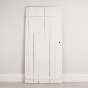 Vintage shed door painted in white