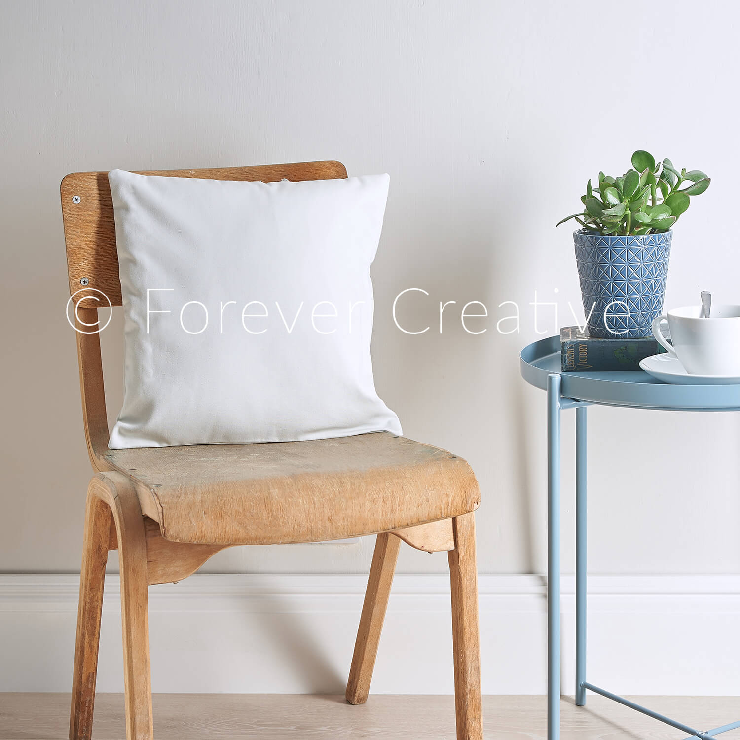 Stock photograph of a blank cushion in minimal setting ready for designer to superimpose their artwork