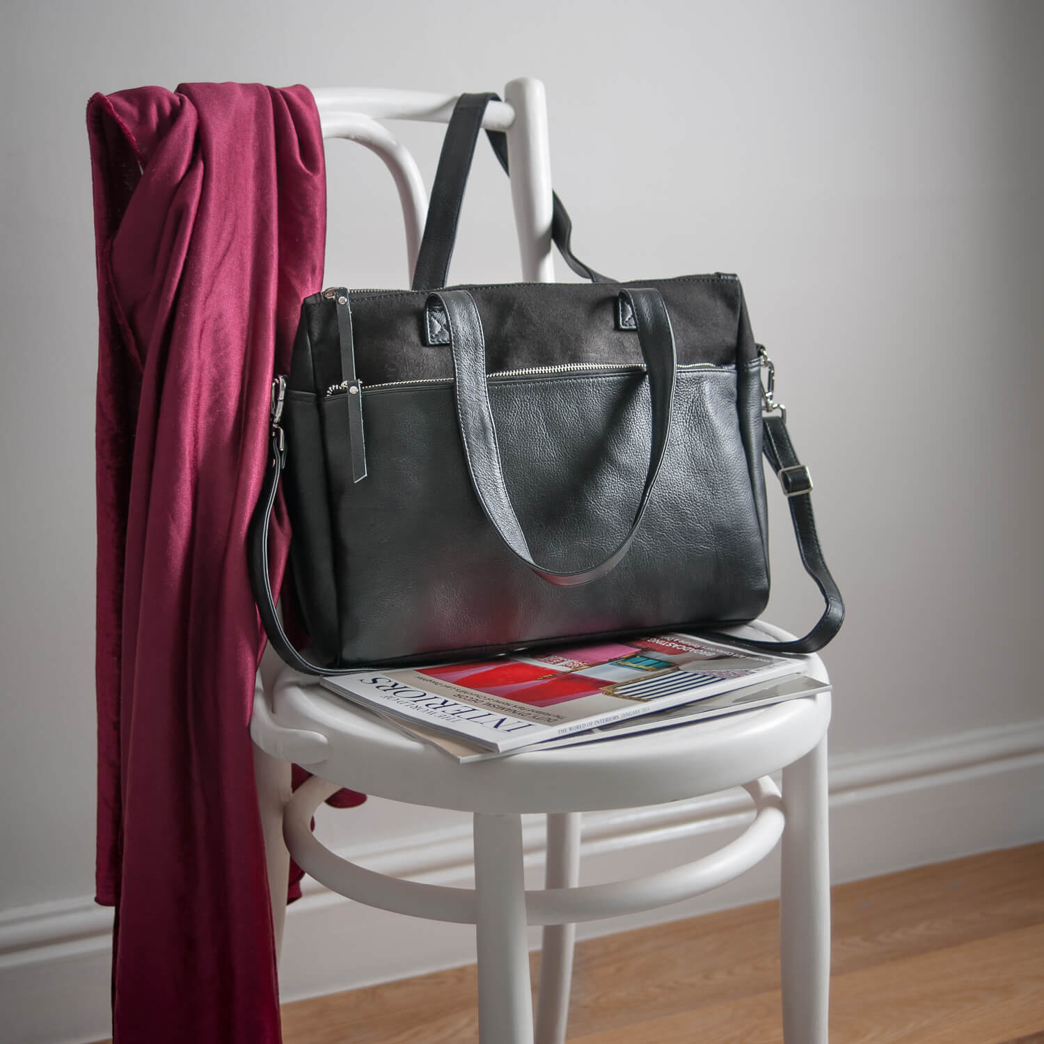 Hydestyle London ladies bag photographed simply with magazine on vintage chair