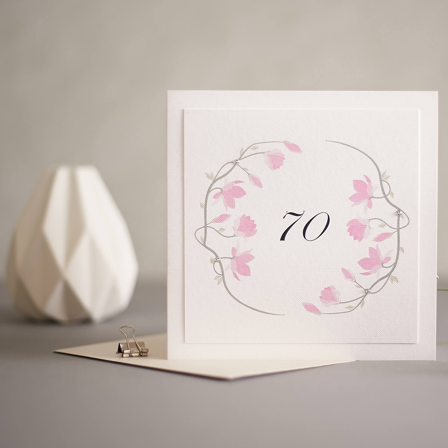 Softly lit greetings card image with geometric modern props