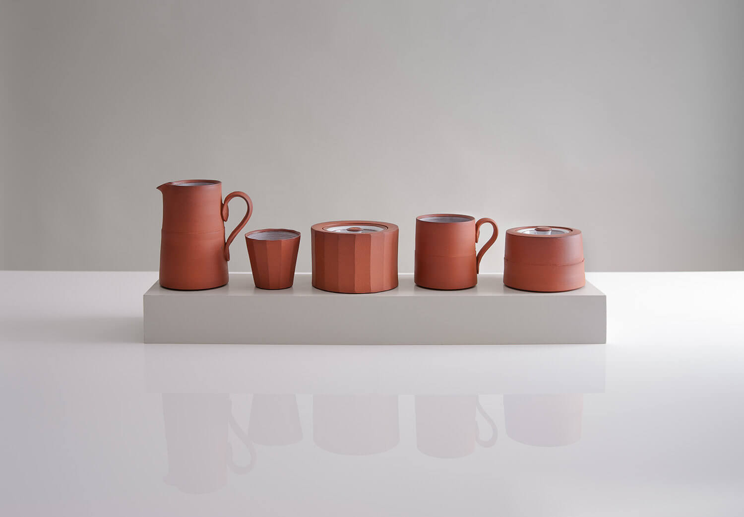 Studio lit product photograph of handmade ceramics with reflection