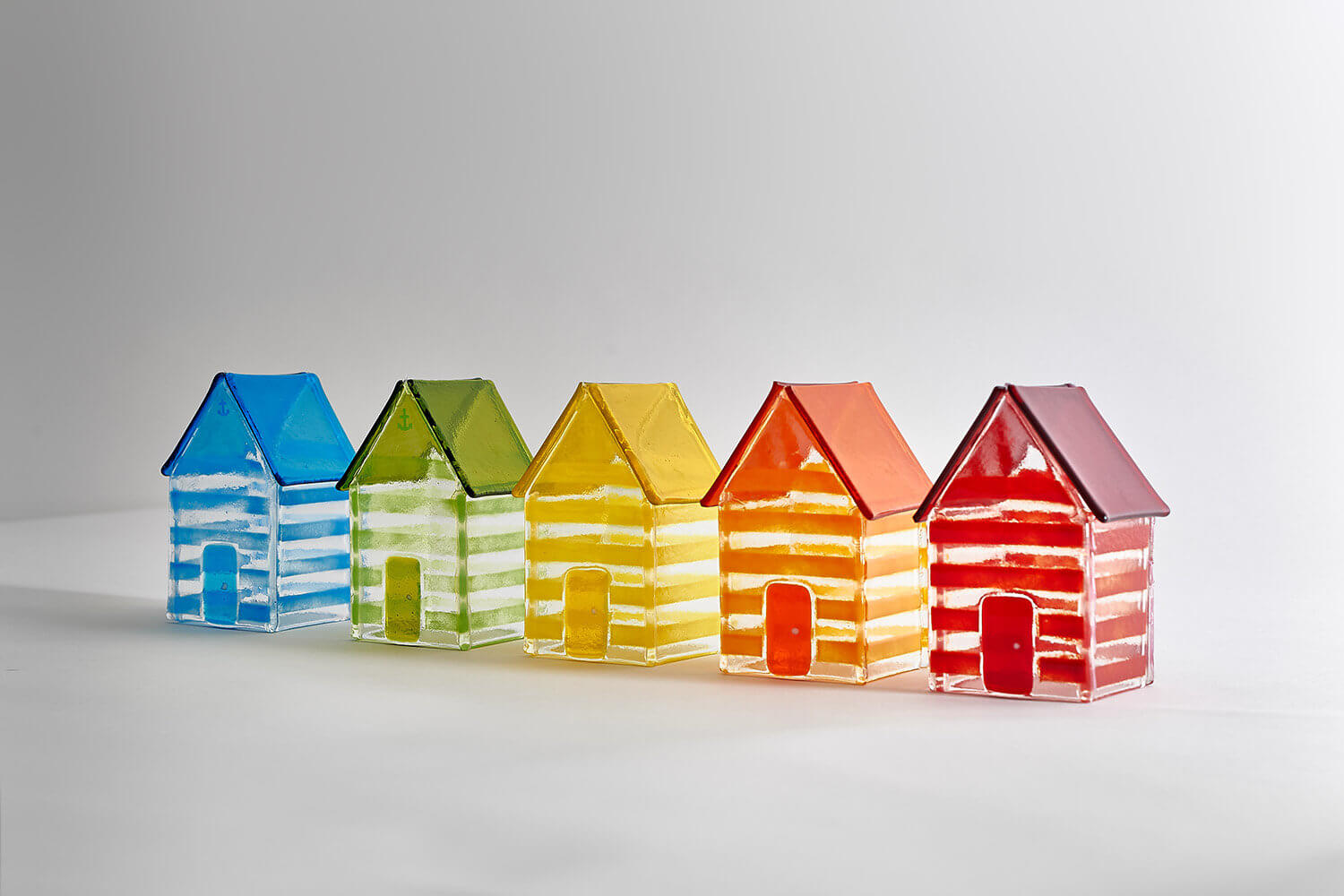 Glass art chalets photographed with gradient light