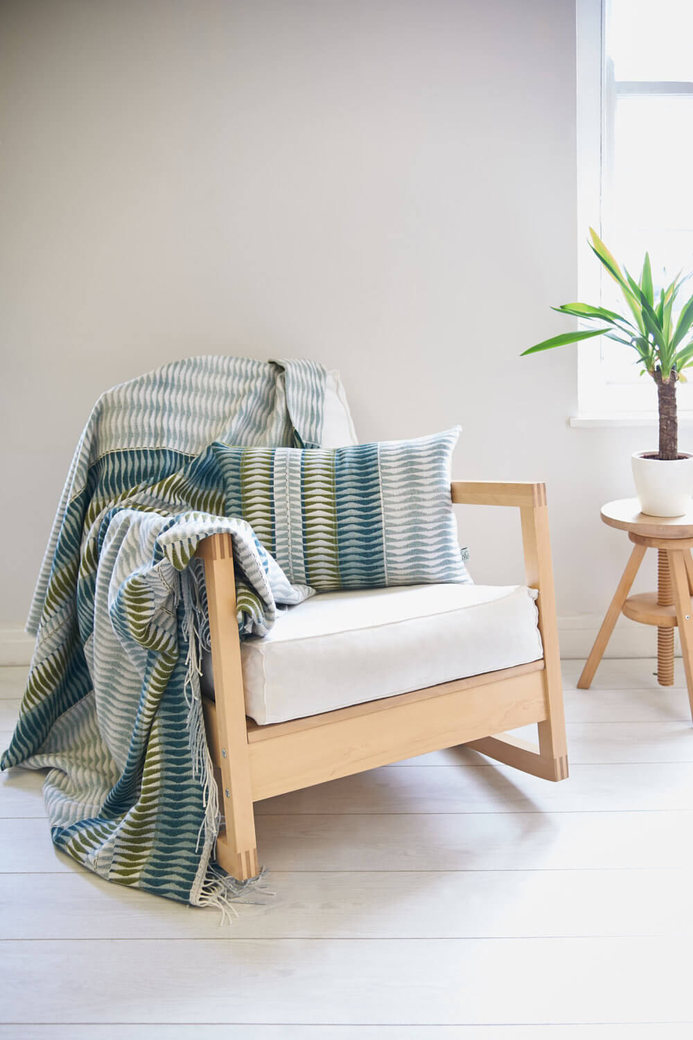 Contemporary setting for this throw by designer Camilla Thomas Textiles