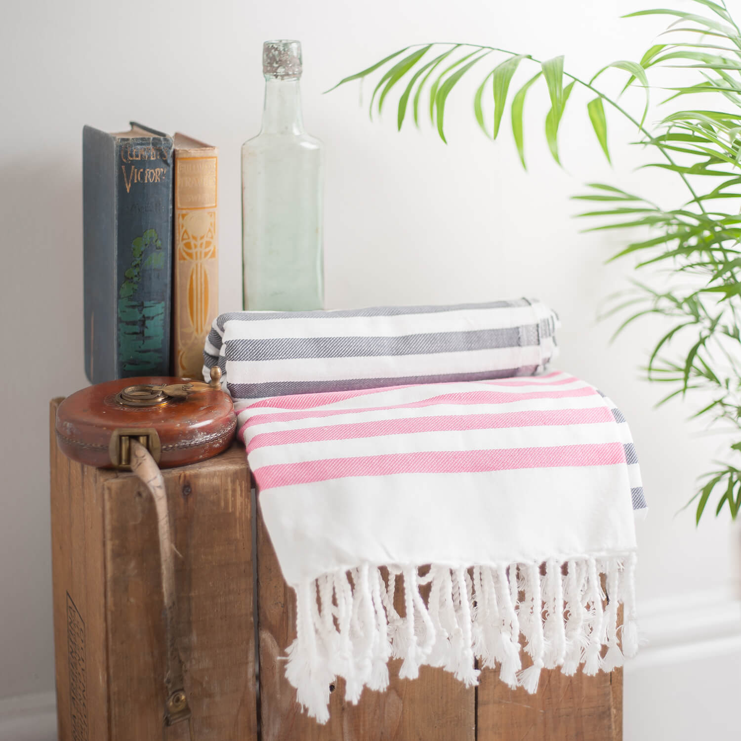 Palm plant leaves in this styled photograph of a towel / throw