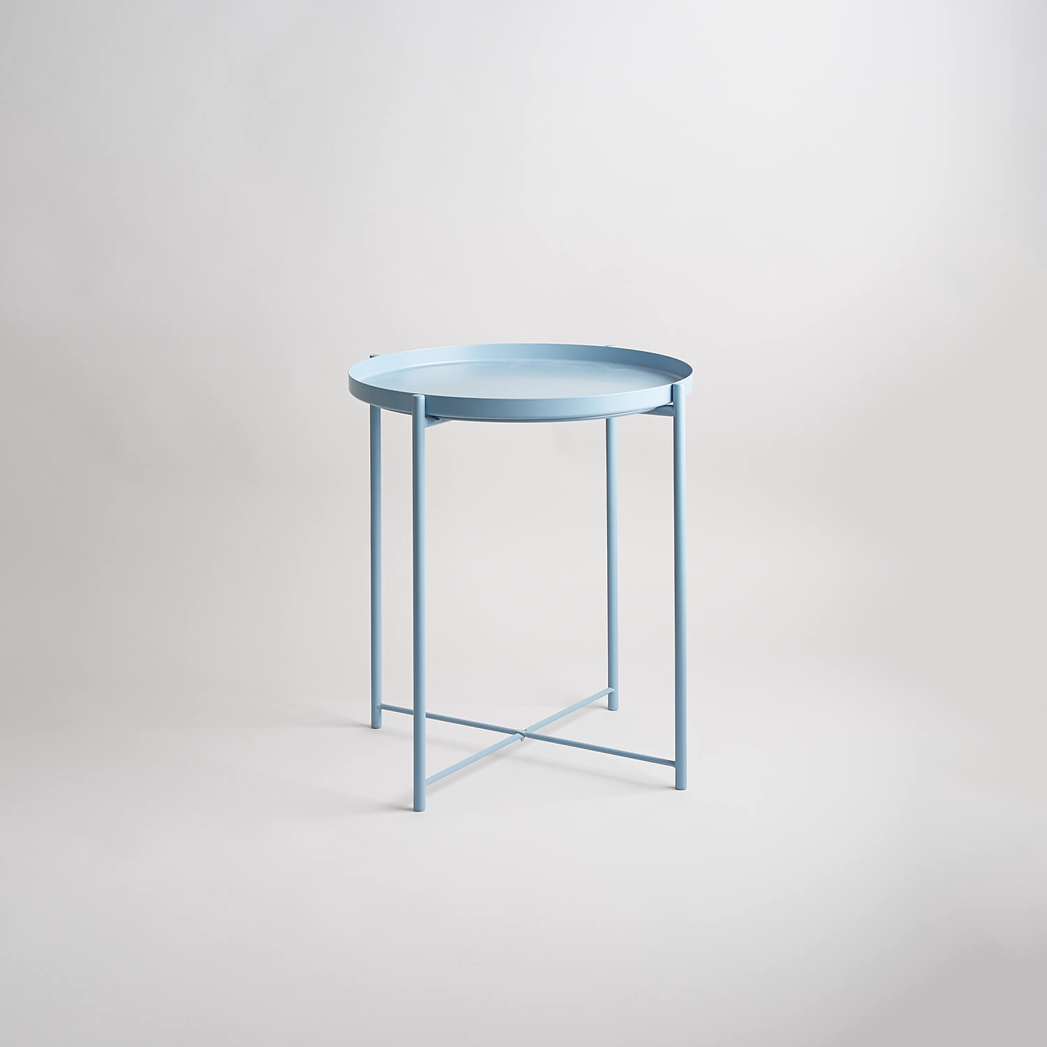Ikea metal tray table in blue part of the modern set of furniture in stock at the studio