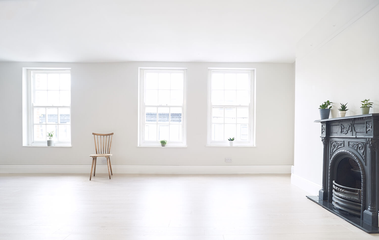Product photography studio with period features including skirting boards, sash windows and cast iron fireplace