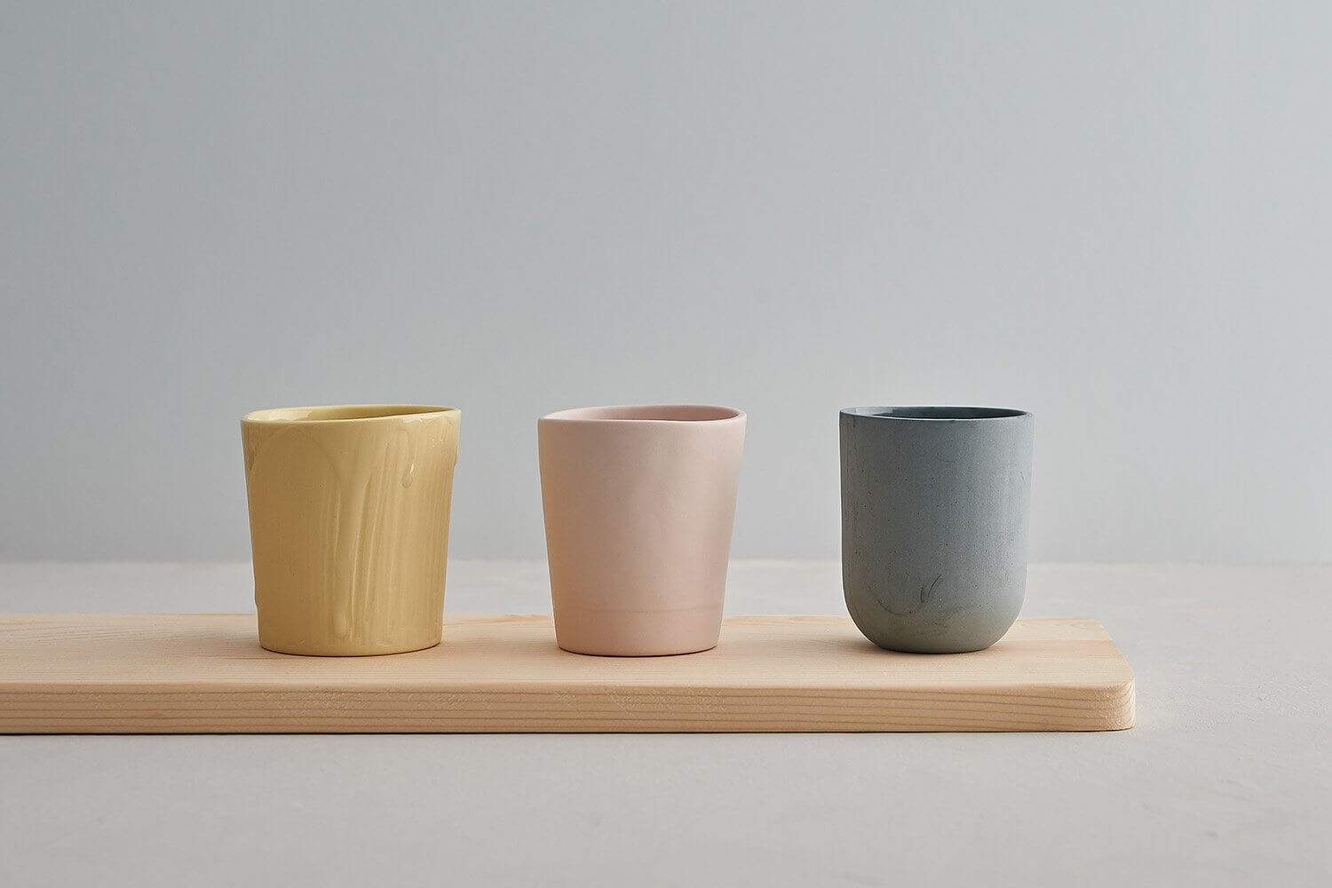 Contemporary handmade ceramics photographed against subtle coloured backdrop