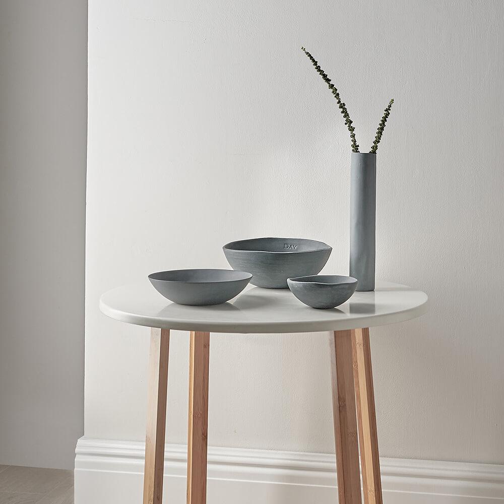 Handmade ceramics photographed on modern side table