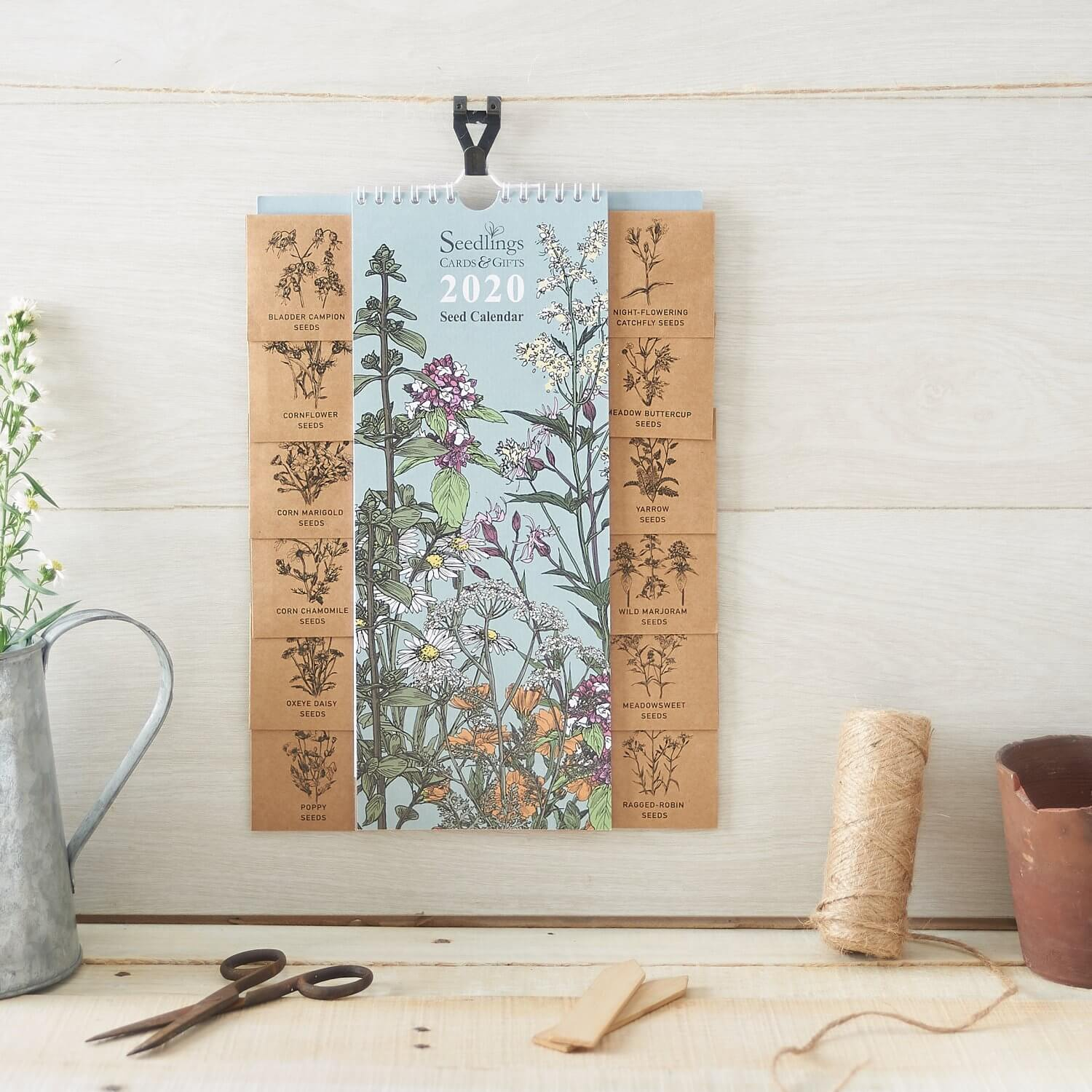 Rustic backdrop and surface used in this product photograph of a Seedlings calendar