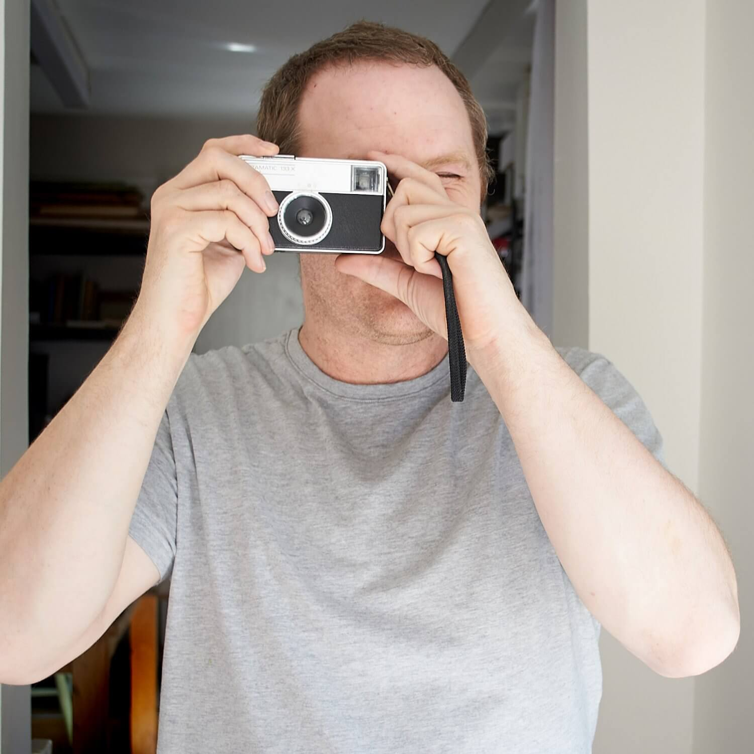 Portrait of Richard Jackson of Forever Creative showing one of the vintage cameras from the studios prop store