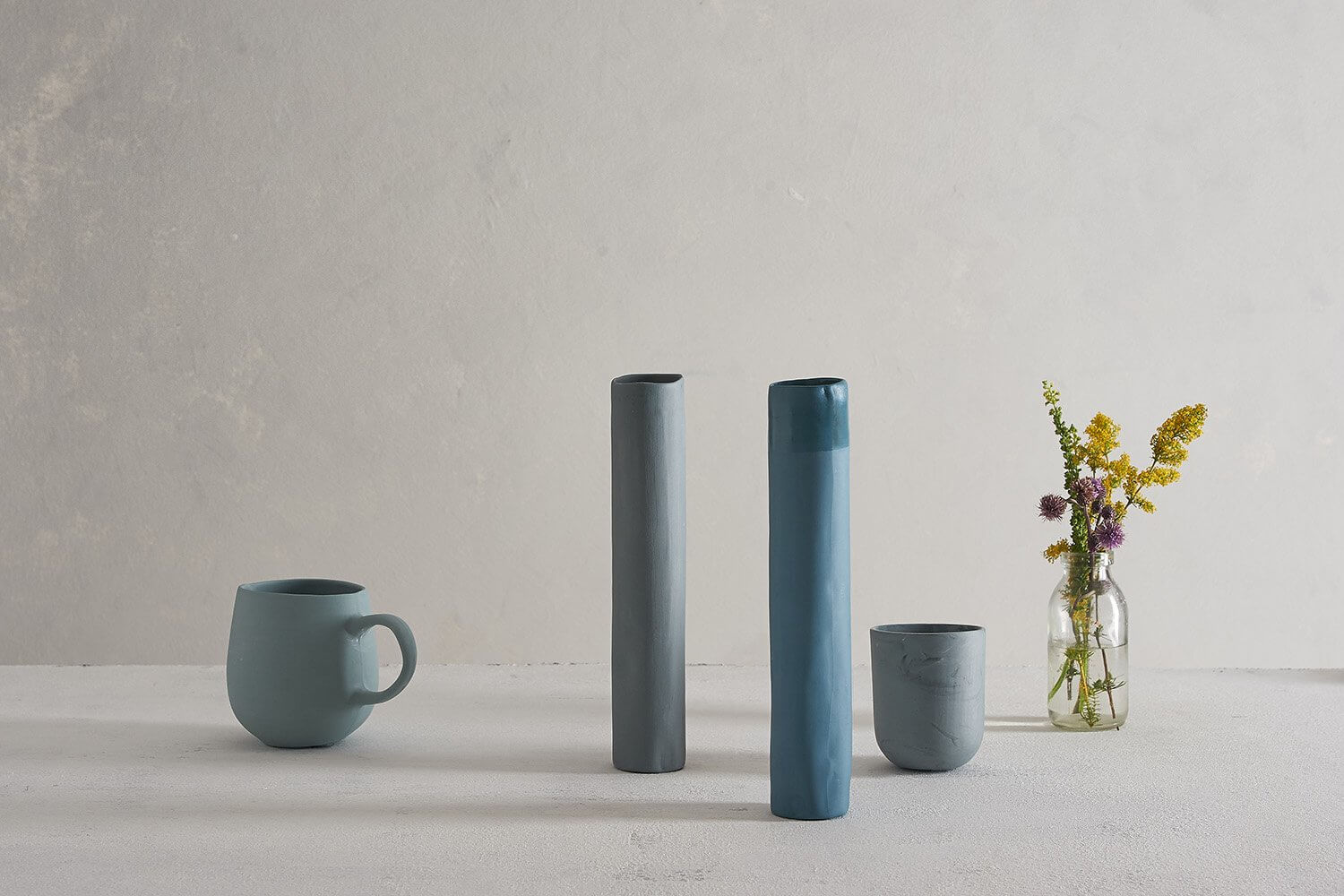 A still life art photograph with handmade ceramic vases cups and mugs by Febbie Day Ceramics