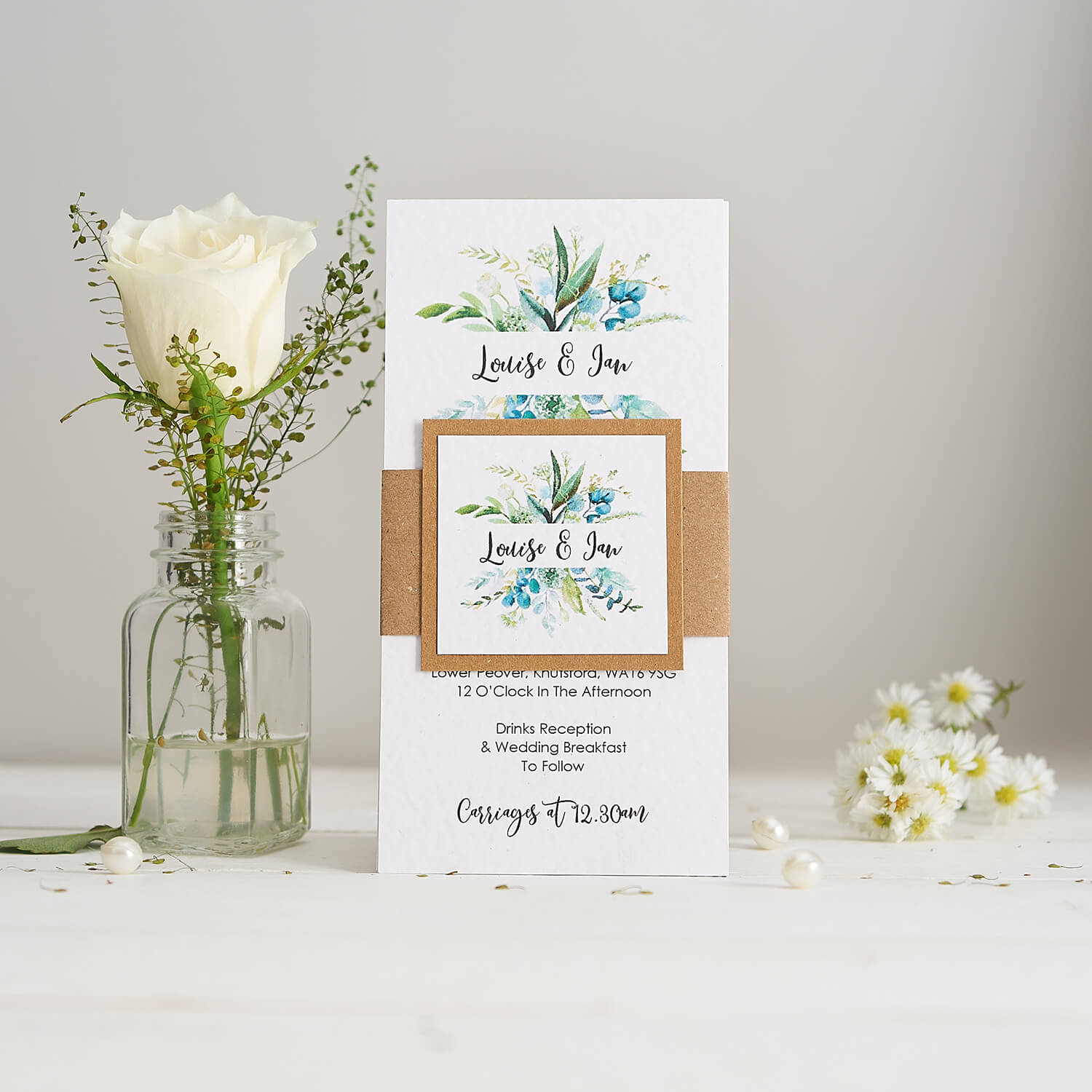 Stationery photography of handmade wedding invites featuring fresh flowers