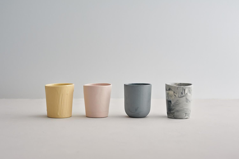 Simple contemporary photograph of small ceramic beakers