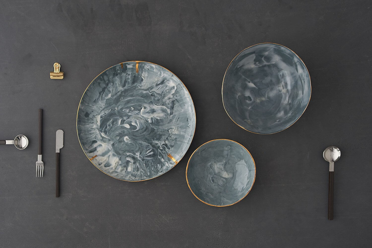 Overhead flatlay style photograph of handmade ceramics plates and bowls by Febbie Day Ceramics