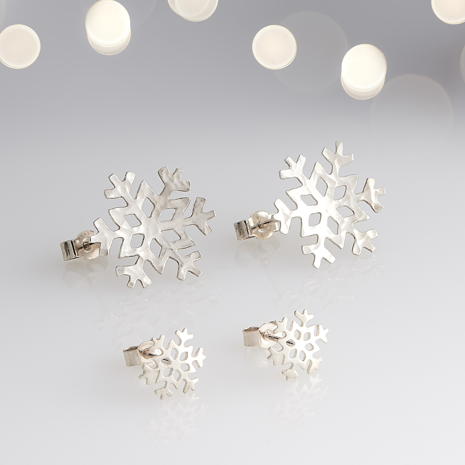 Product image of cufflinks handmade from silver and styled in the appearance of snowflakes