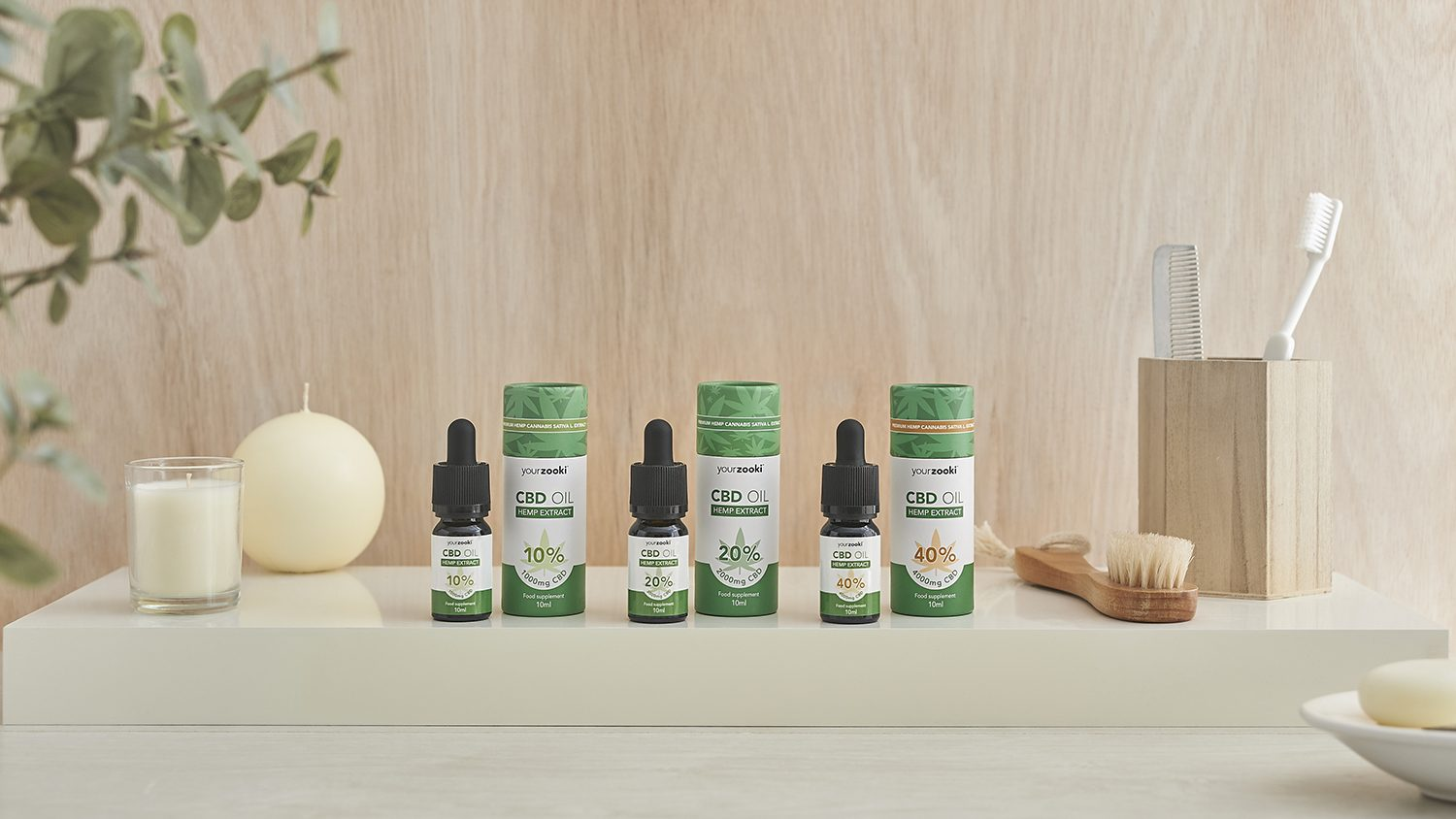 A photograph of the full range of CBD oil products from Your Zooki in a Lifestyle Setting