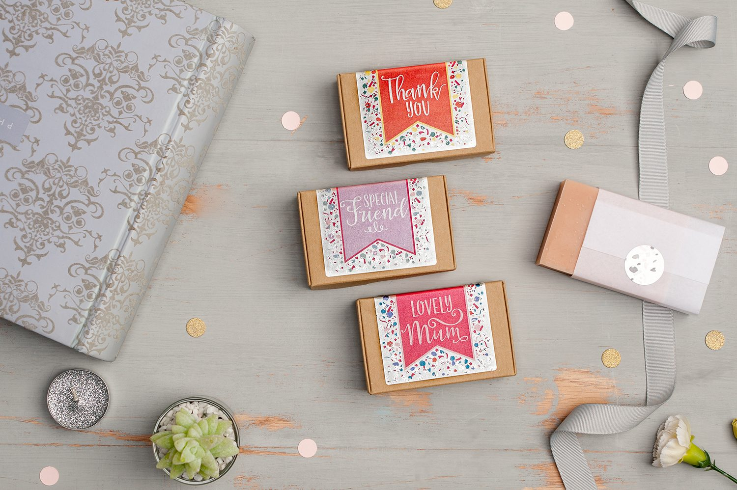 Group overhead photograph of packaged soaps by the Handcrafted Card Co.