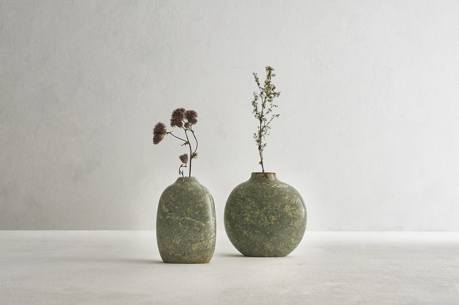 A still life photograph of stone sculpture vessels