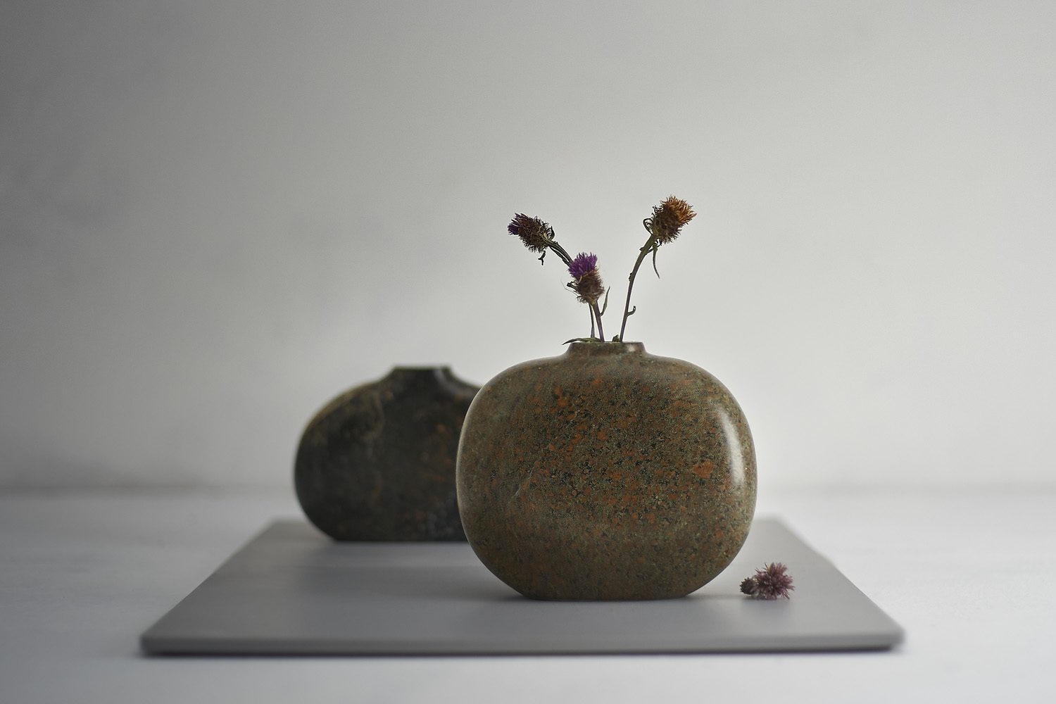 Still life product photograph of stone sculpture vases