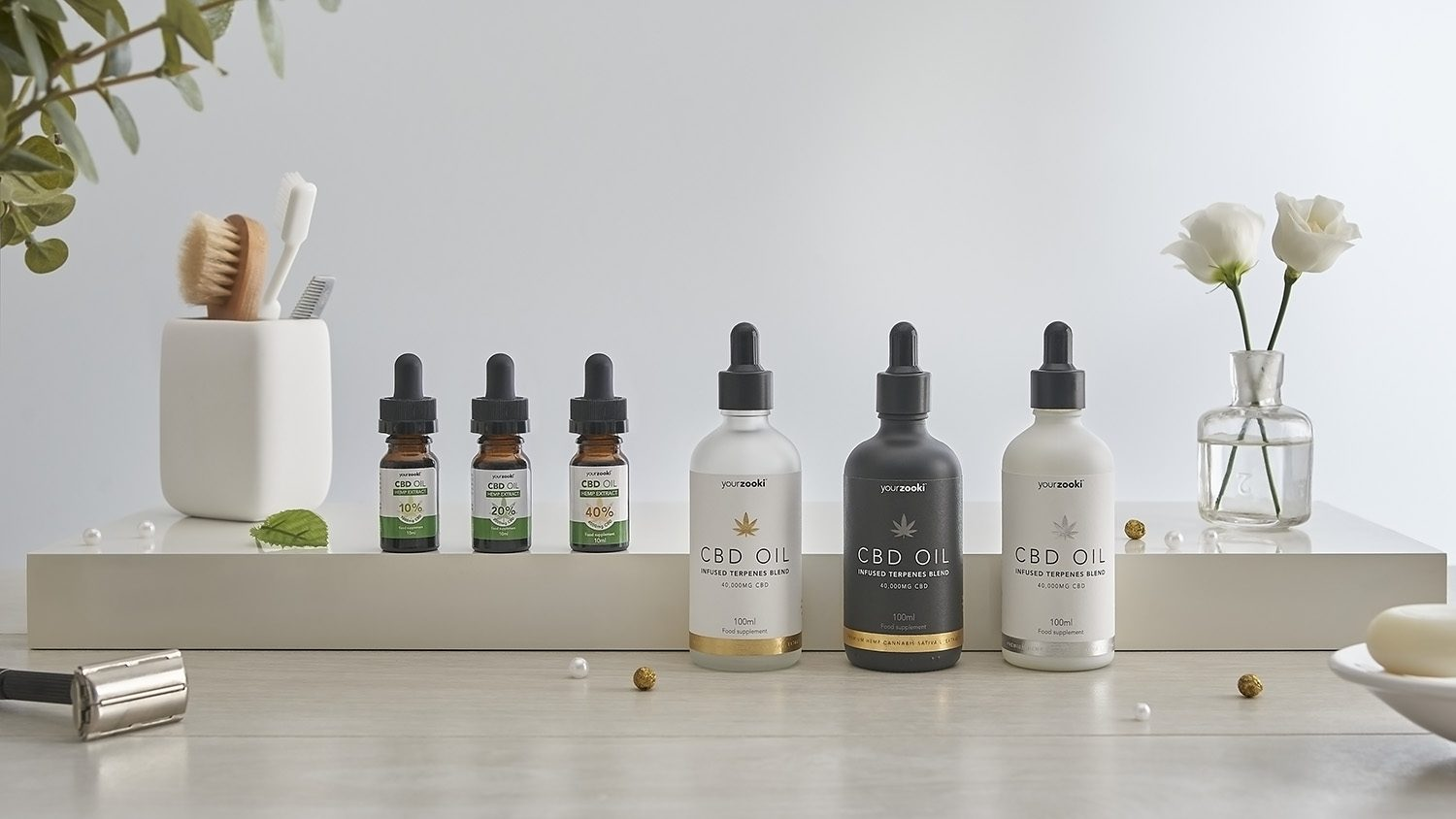 Group product photograph of apothecary bottles in lifestyle minimal setting for client Your Zooki