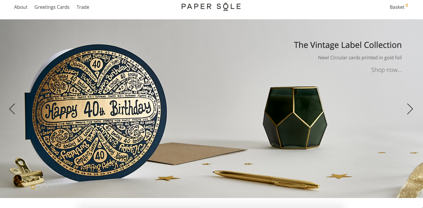 A screenshot of a web banner from the Paper Sole designer's website