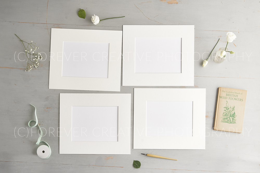 Overhead photograph of mounted prints blank for surface pattern designers to superimpose their work into