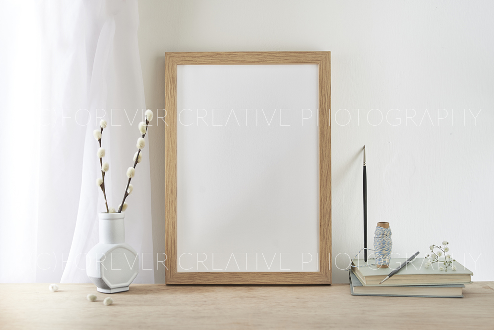 A designer's template image showing a styled photography in-situ with a framed blank
